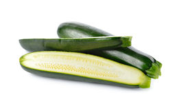 Whole and portion cut fresh Zucchini on white Stock Images