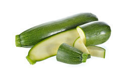 Whole and portion cut fresh Zucchini on white background Royalty Free Stock Photos