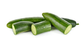 Whole and portion cut Japanese cucumber on white Stock Photo
