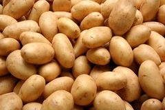 Whole Potatoes. Heap of raw potatoes in a shop Royalty Free Stock Images