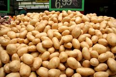 Whole Potatoes in Shop Royalty Free Stock Image