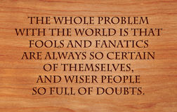 The whole problem with the world. Is that fools and fanatics are always so certain of themselves, and wiser people so full of doubts - quote by Bertrand Russel Stock Photo