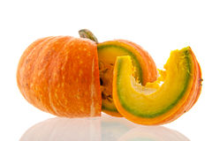 Whole pumpkin with cut slice Stock Images