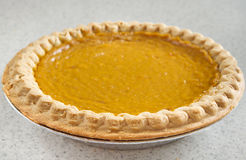 Whole pumpkin pie Stock Photography