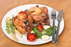 Whole Quails with Vegetables Stock Images