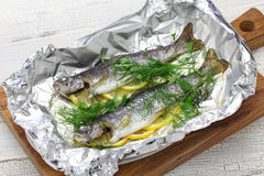 Whole rainbow trout baked in foil Stock Photography