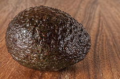 Whole raw avocado,cutting board Stock Photos