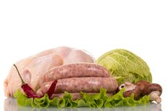 Whole raw chicken carcass, chicken sausages, Savoy cabbage, pepp. Er, mushrooms and lettuce leaves isolated on white background Royalty Free Stock Image