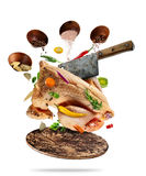 Whole raw chicken with ingredients, food preparation concept. Whole raw chicken with ingredients for cooking, served on woodenboard. Concept of food preparation Royalty Free Stock Images