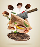 Whole raw chicken with ingredients, food preparation concept. Whole raw chicken with ingredients for cooking, served on woodenboard. Concept of food preparation Royalty Free Stock Photos