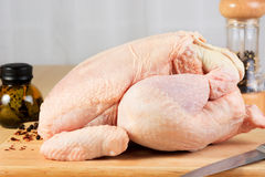 Whole raw chicken on a plank Royalty Free Stock Photo