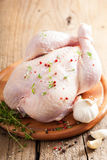 Whole raw chicken with rose pepper and thyme Stock Photography
