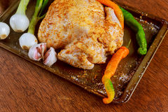 Whole raw chicken seasoned with butter and herbs for roasting. Top view, Stock Photos