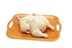 Whole raw chicken in the tray isolated Royalty Free Stock Images