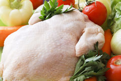 Whole raw chicken with vegetables. Ready to be prepared royalty free stock photos
