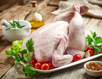 Whole raw chicken. On wooden kitchen table Stock Image