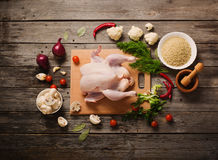 Whole raw chicken on  wooden table. Whole raw chicken on a wooden table Stock Photography
