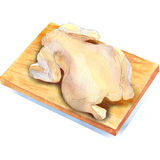 Whole raw chicken on a wooden table . Royalty Free Stock Photography