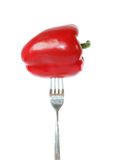 Whole red bell pepper pinned on a fork Royalty Free Stock Images