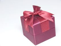 Whole red gift box. Red gift box with red ribbon Stock Photos