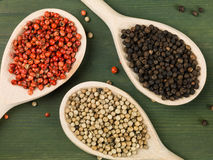 Whole Red White and Black Pepper Corns Royalty Free Stock Photos