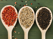 Whole Red White and Black Pepper Corns Royalty Free Stock Photography