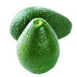 Whole ripe Avocado isolated on white background. Two Fresh green Royalty Free Stock Photos