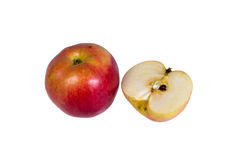 Whole ripe, juicy apple and a half on a white background. Royalty Free Stock Images
