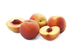 Whole ripe peach and peach halves Royalty Free Stock Image