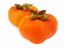 Whole ripe Persimmon Royalty Free Stock Photos