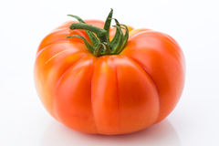 Whole ripe red tomato, isolated Stock Images