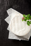 Whole ripened fresh round camembert cheese Royalty Free Stock Images