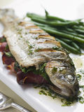 Whole River Trout with Jamon and Herb Butter.  royalty free stock photos