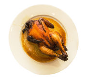 Whole roast chicken for dinner in a ceramic plate Royalty Free Stock Photography
