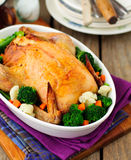 Whole Roast Chicken Stuffed with Bread and Cheese Served with St Royalty Free Stock Photography