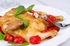 Whole roast chicken with tomatoes cherry, green basil and garlic. Stock Photo