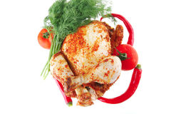 Whole roast chicken with vegetables Stock Photo
