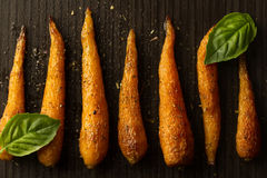 Whole roasted carrots with spices in a skillet. Stock Images