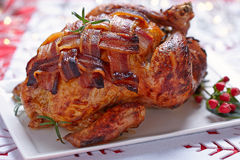 Whole roasted chicken with bacon. For holiday Royalty Free Stock Image