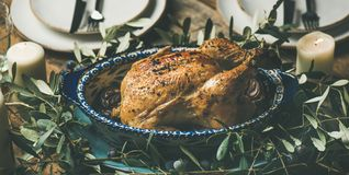 Whole roasted chicken decorated with olive tree branch, selective focus Stock Photos