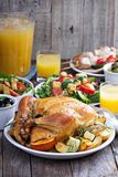 Whole roasted chicken on dinner table Stock Images