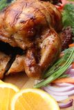 Whole roasted chicken with fresh vegetables Stock Photography