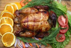 Whole roasted chicken with fresh vegetables Royalty Free Stock Photography