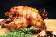 Whole roasted chicken with fresh vegetables Royalty Free Stock Photo