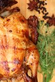Whole roasted chicken with fresh vegetables Royalty Free Stock Photos