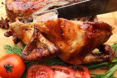 Whole roasted chicken with fresh vegetables Stock Image