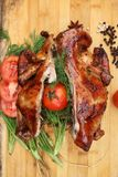 Whole roasted chicken with fresh vegetables Stock Photo