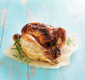Whole roasted chicken with herbs Stock Photo