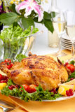 Whole Roasted Chicken On Table Stock Images
