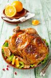 Whole roasted chicken with oranges Stock Image